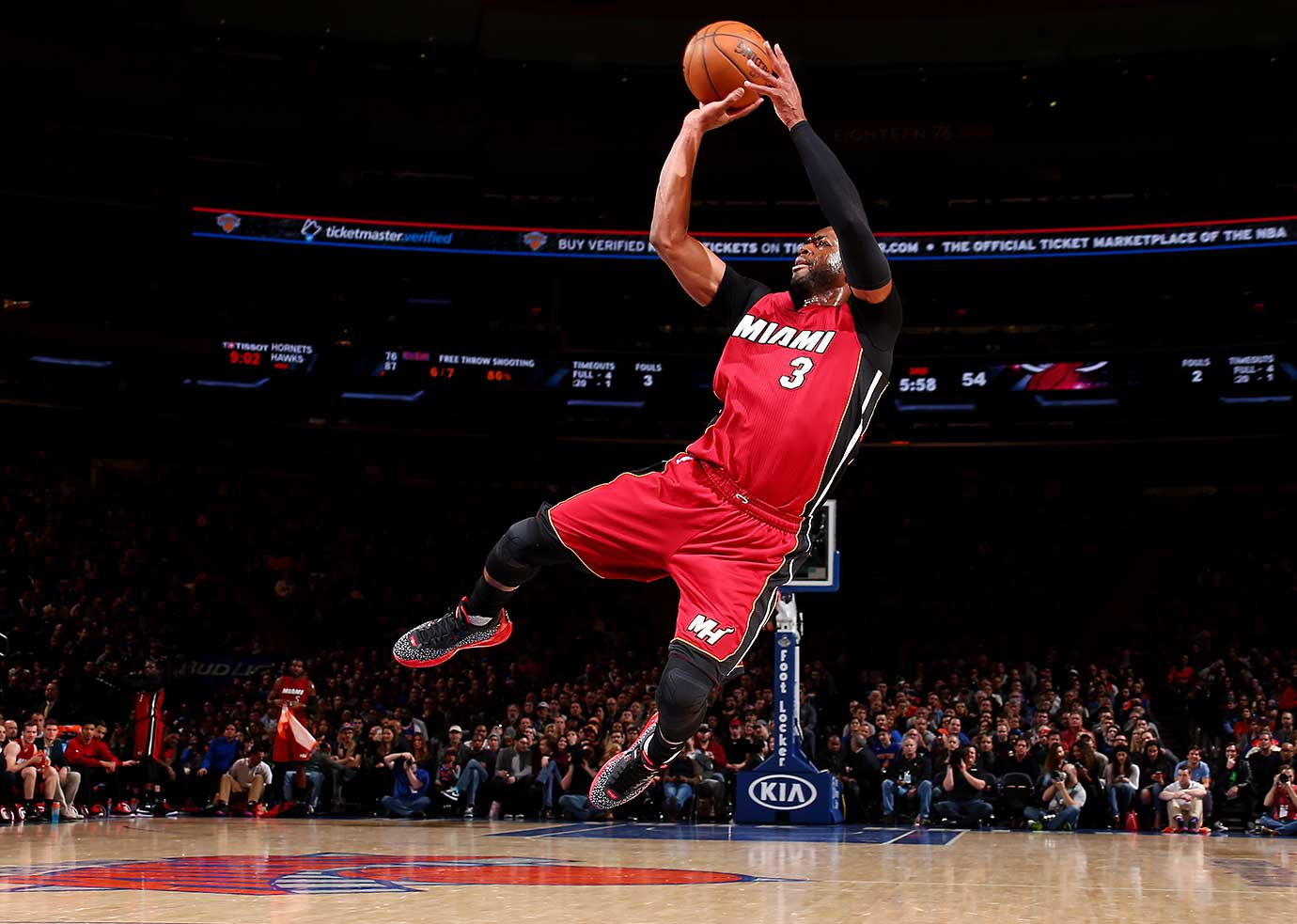 Which was the stranger sight, this shot by Dwyane Wade or the outfit he arrived in for Sunday's game?