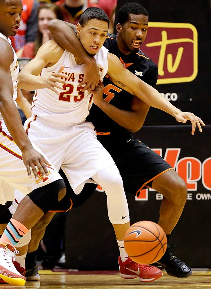Oklahoma State guard Tavarius Shine, right, wraps up Iowa State guard Jordan Ashton.