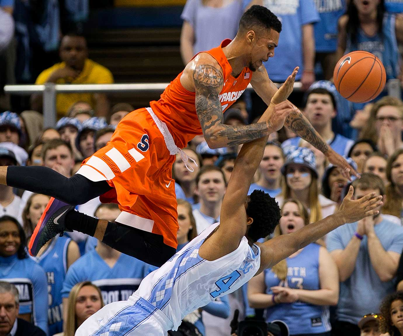 Syracuse's Michael Gbinije collides with North Carolina's Isaiah Hicks.