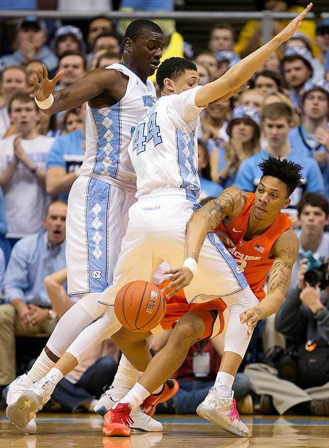 North Carolina's Joel James and Justin Jackson trap Syracuse's Malachi Richardson.