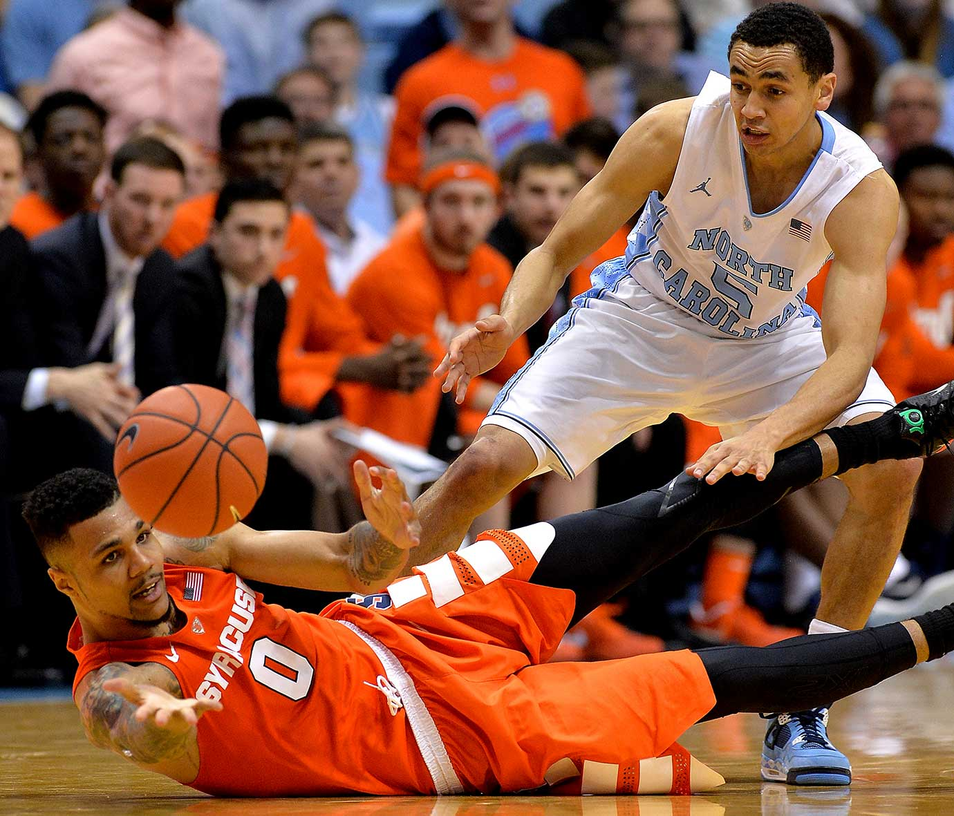 Michael Gbinije of the Syracuse Orange battles Marcus Paige of North Carolina for a loose ball.