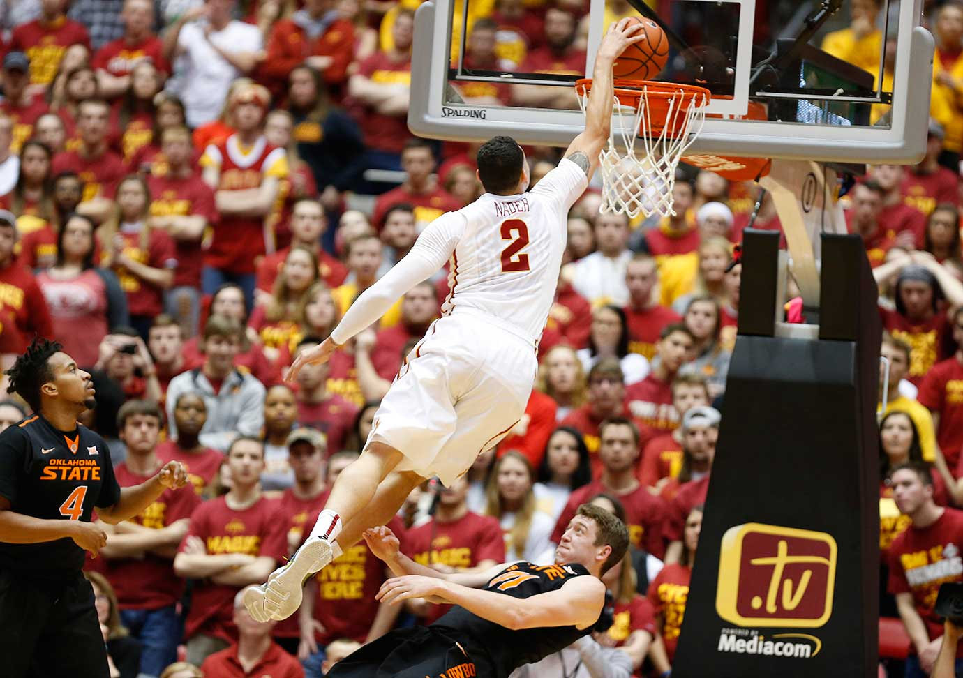Abdel Nader of the Iowa State Cyclones dunks as Joe Burton (4) and Mitchell Solomon defend.