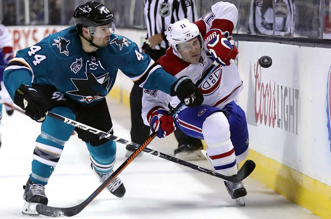 Marc-Edouard Vlasic of San Jose and Brendan Gallagher of Montreal go for the puck.