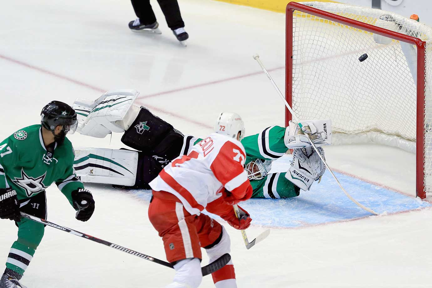 Andreas Athanasiou of the Detroit Red Wings scores against Antti Niemi of the Dallas Stars.