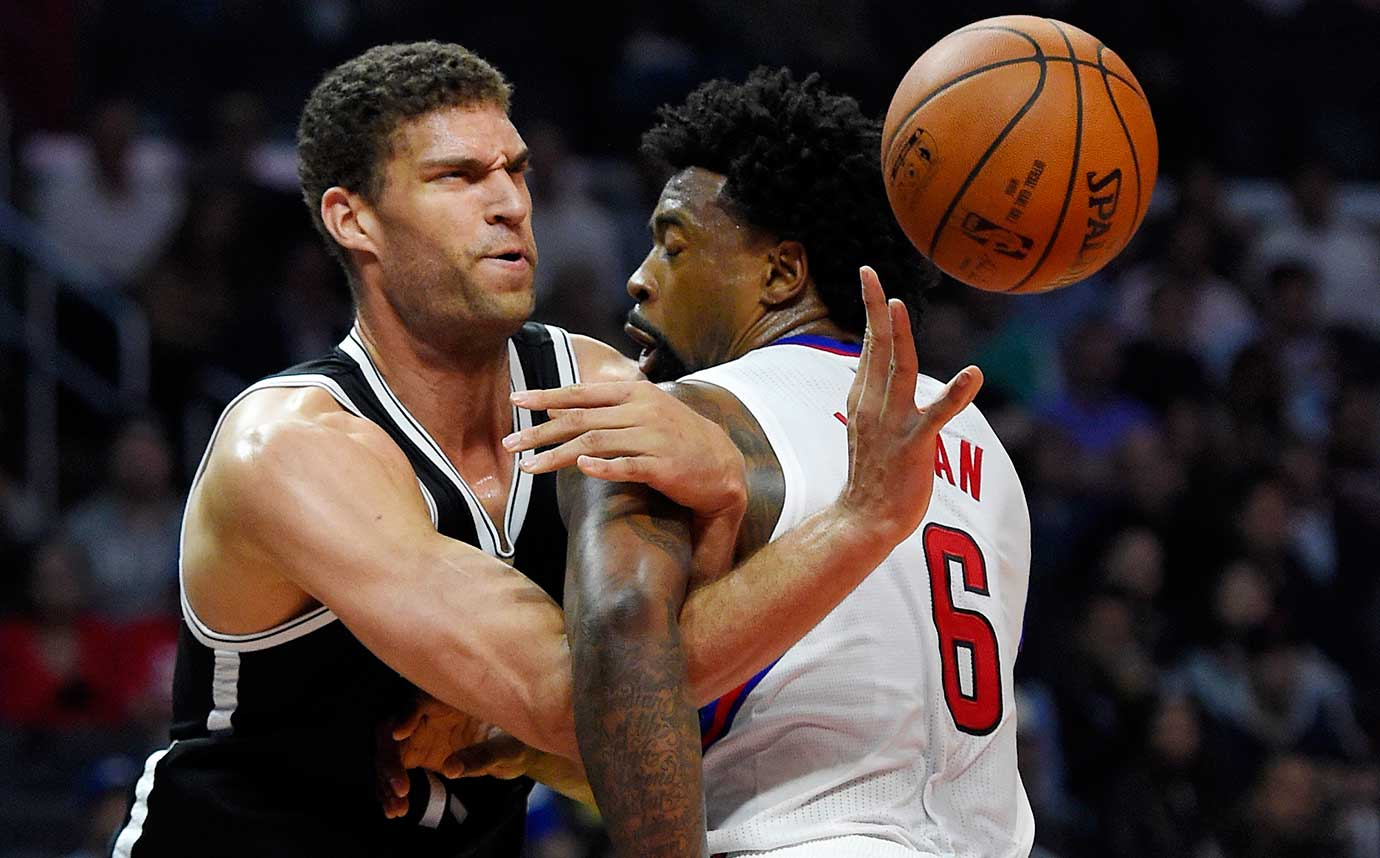 Brooklyn Nets center Brook Lopez tangles with Los Angeles Clippers center DeAndre Jordan.