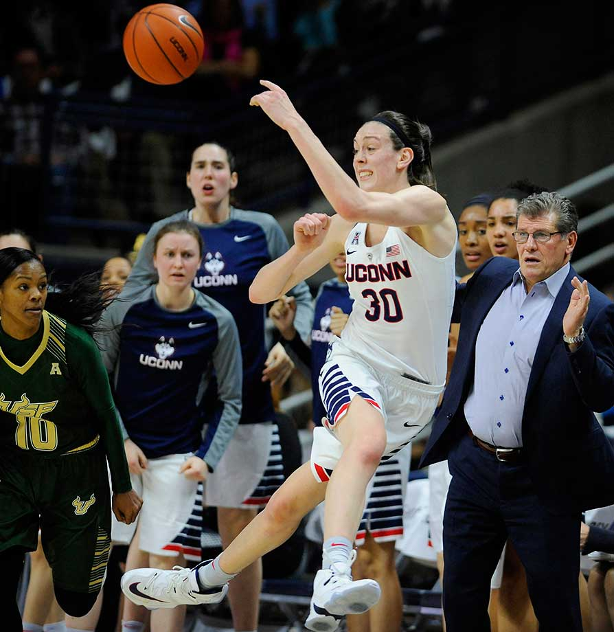 UConn's Breanna Stewart keeps the ball inbounds as coach Geno Auriemma looks on.