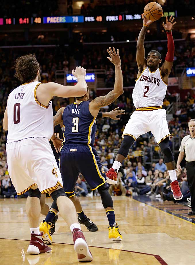 Cleveland's Kyrie Irving passes over Indiana's George Hill to Kevin Love.