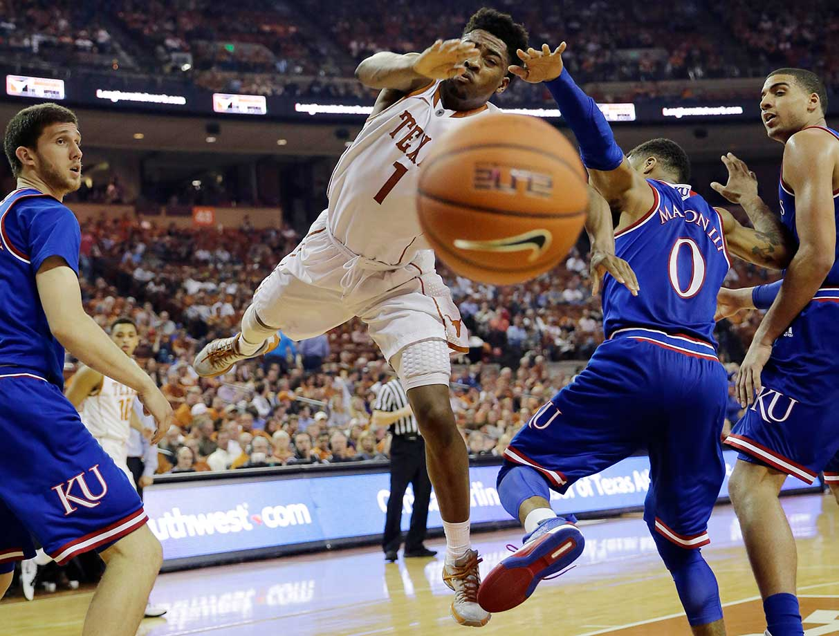 Texas guard Isaiah Taylor looses control of the ball as he tries to drive past Frank Mason III.
