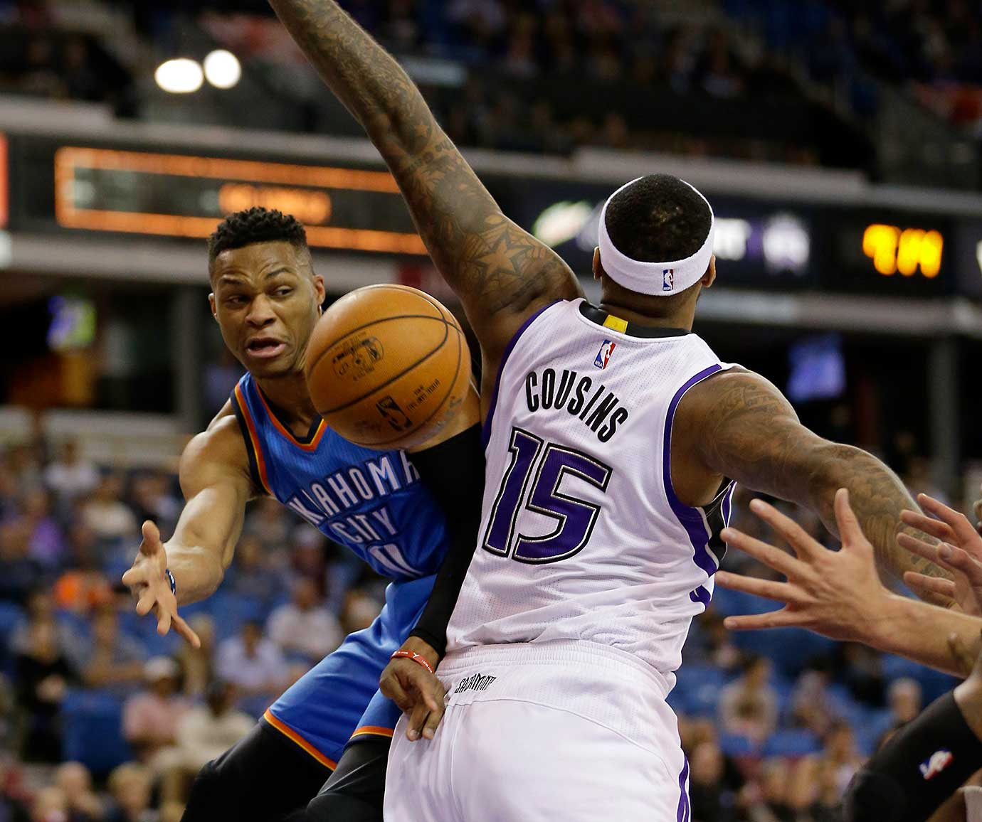 Here are some of the images that caught our eye on the sports night of Feb. 29, starting with Russell Westbrook passing around DeMarcus Cousins.