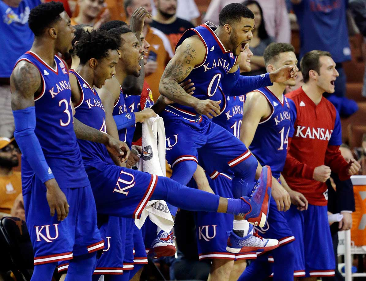 Kansas guard Frank Mason III leaps as he and teammates celebrate a score against Texas.