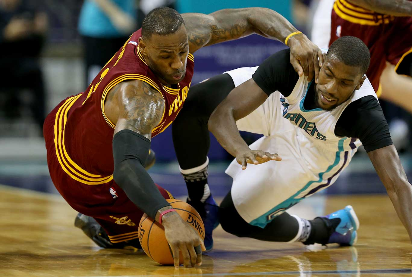 Here are some of the images that caught our eye on the sports night of Feb. 3, starting with LeBron James diving for a loose ball against Michael Kidd-Gilchrist of the Charlotte Hornets at Time Warner Cable Arena in North Carolina.