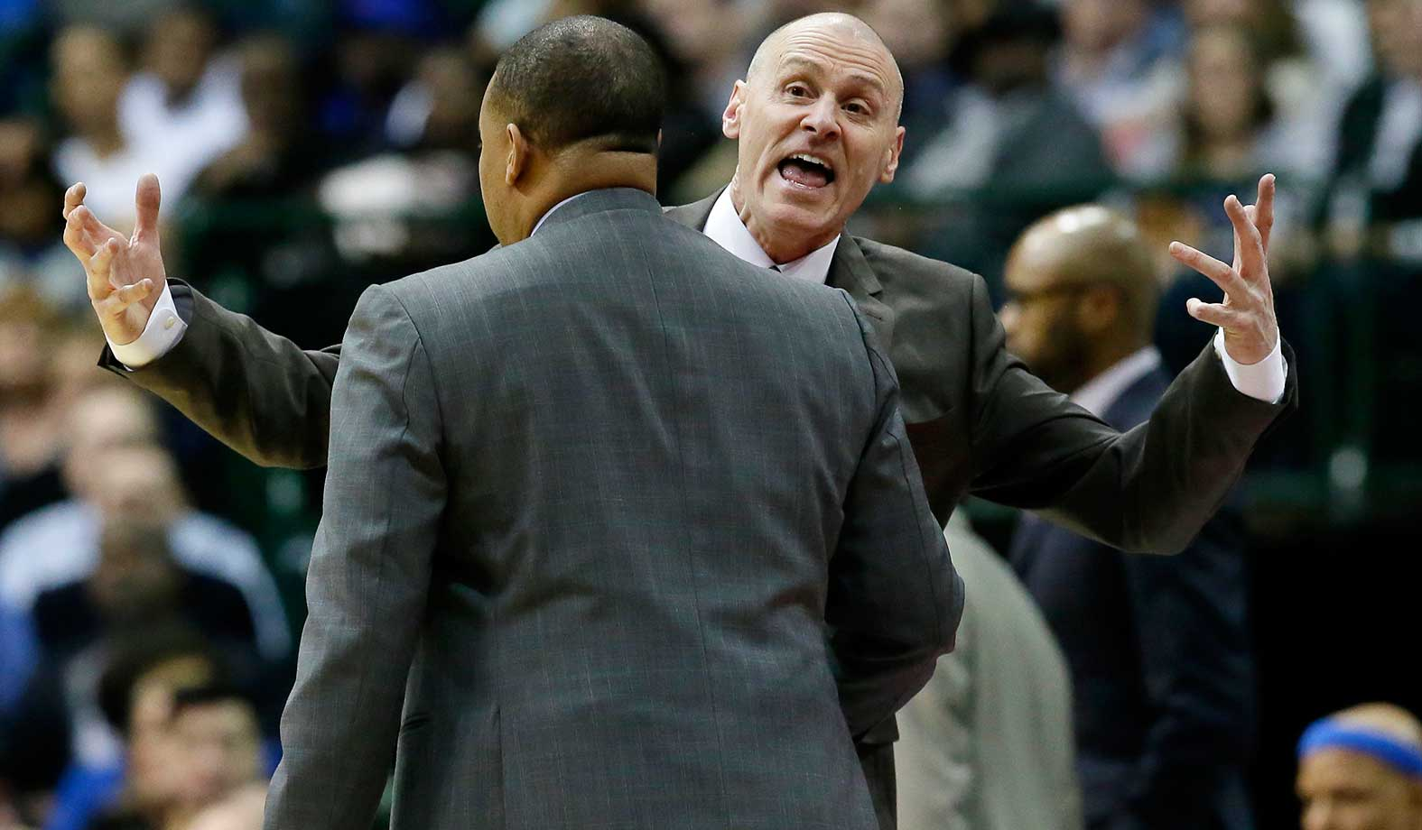 Dallas Mavericks head coach Rick Carlisle is held back after he was called for a technical foul during a game against the Miami Heat in Dallas. The Heat won 93-90.