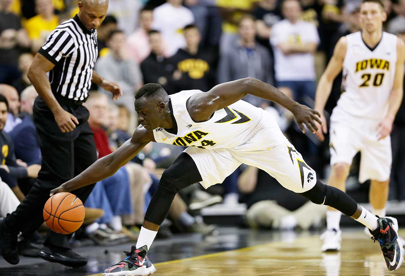 Iowa guard Peter Jok saves the ball from going out of bounds against Penn Statein Iowa City, Iowa.