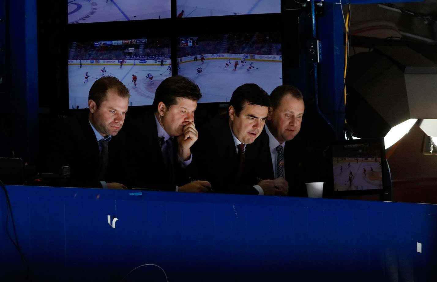 The Calgary Flames staff watches from the press box during the game against the Columbus Blue Jackets at Scotiabank Saddledome in Alberta.