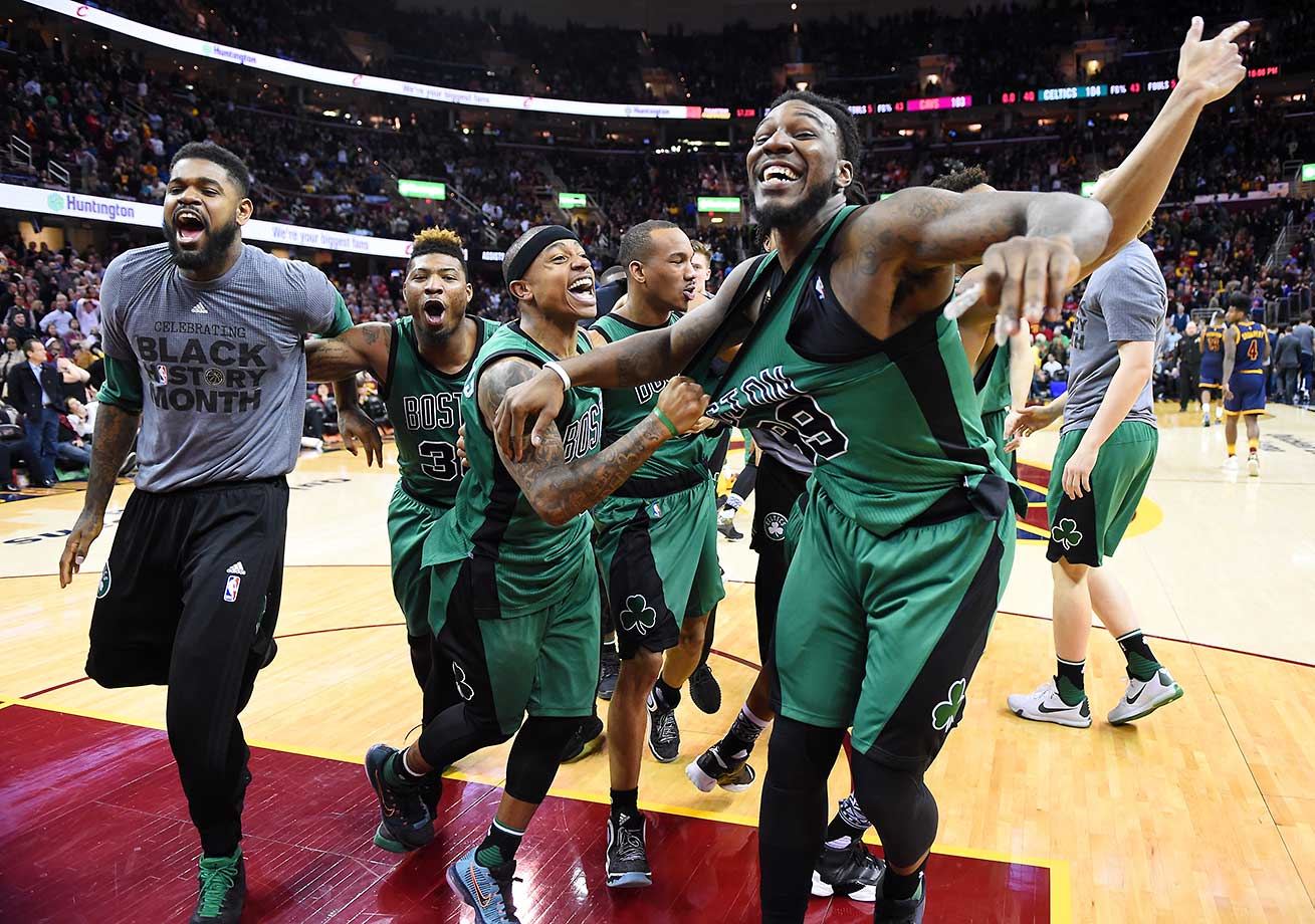 The Boston Celtics celebrate their last-second victory over the Cleveland Cavaliers in Ohio.