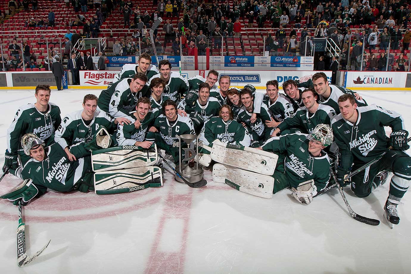 "The victorious Michigan State Spartans after their ""Dual in the D"" win over Michigan at Joe Louis Arena in Detroit."
