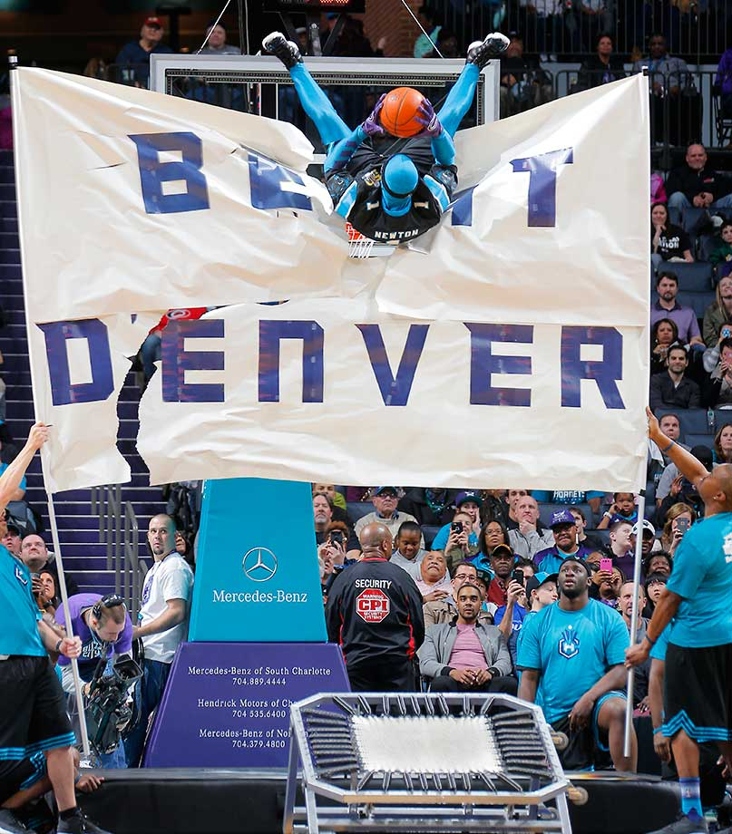 The Charlotte Hornets mascot flips in the air while facing the Denver Nuggets in Charlotte.
