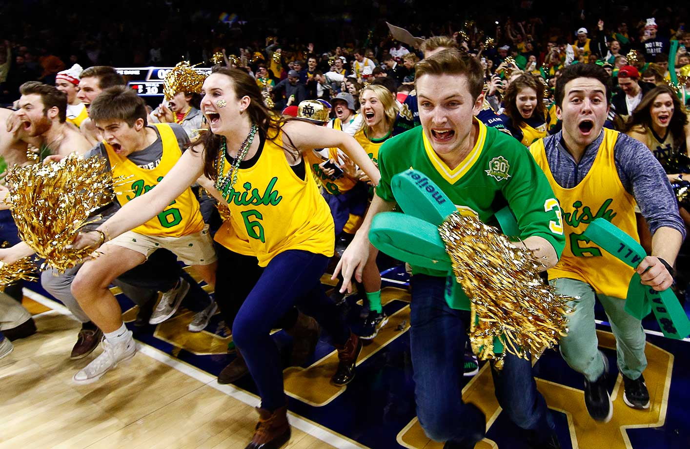 Notre Dame students rush the court following their team's 80-76 win over No. 2 North Carolina.