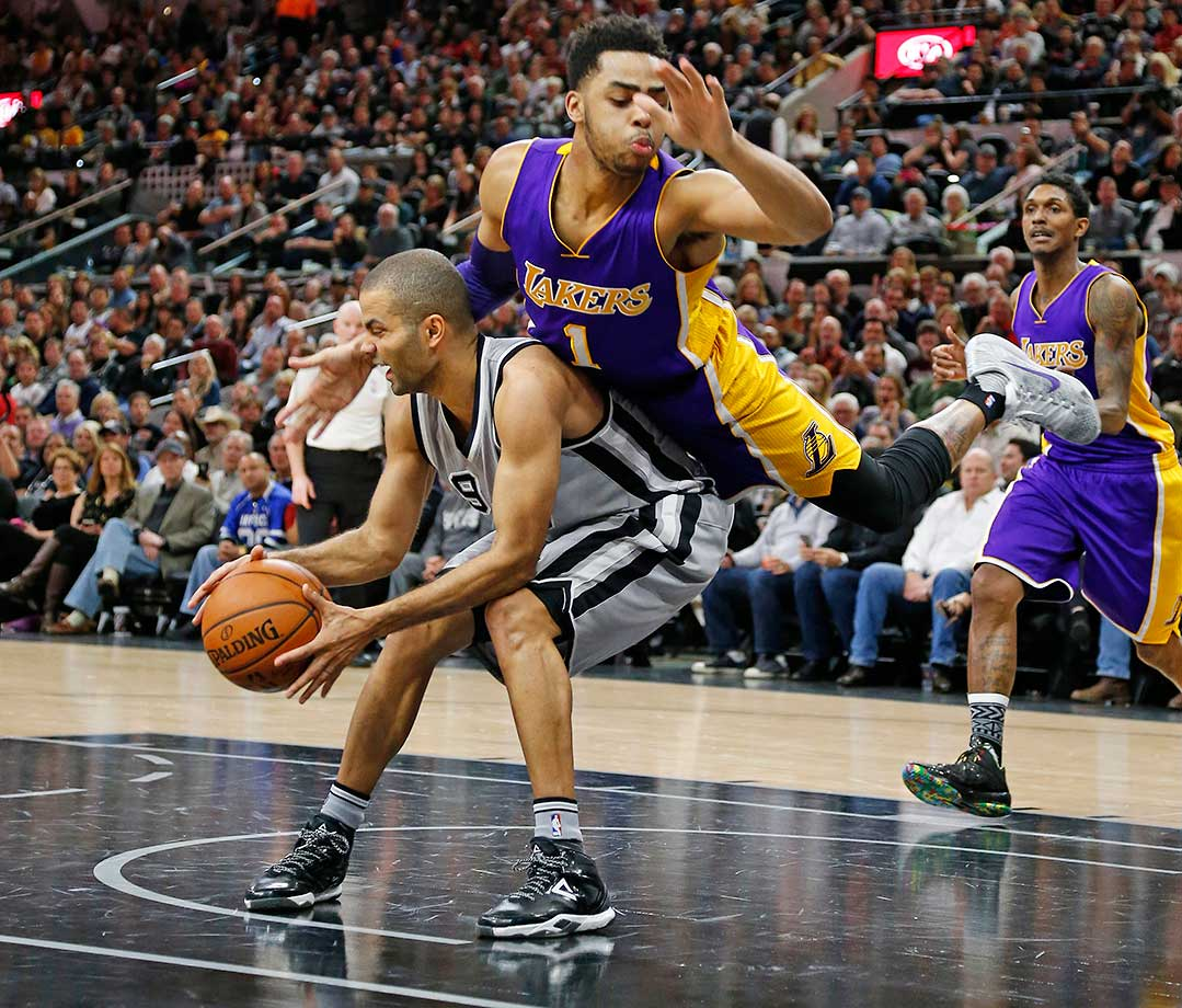 Tony Parker of the San Antonio Spurs is fouled by D'Angelo Russell of the Los Angeles Lakers.