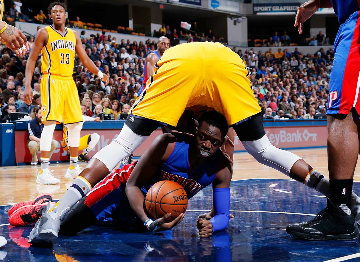 Reggie Jackson of the Detroit Pistons scrambles for a loose ball against the Indiana Pacers.
