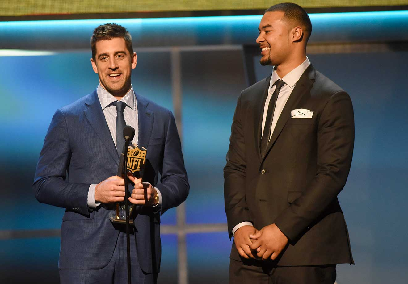 The Hail Mary duo of Aaron and Richard Rodgers accept the Play of the Year award in San Francisco.