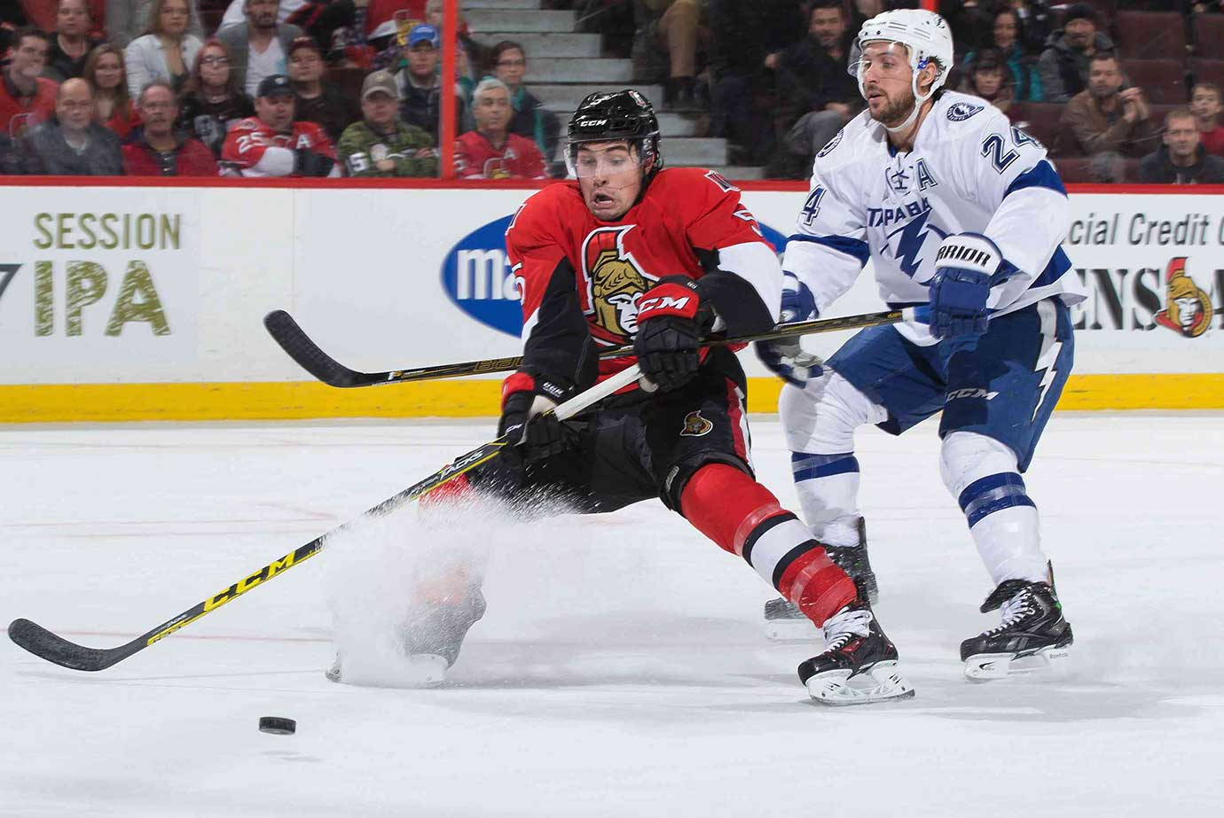 Ryan Callahan hooks Cody Ceci of Ottawa off a scoring chance, resulting in a penalty.