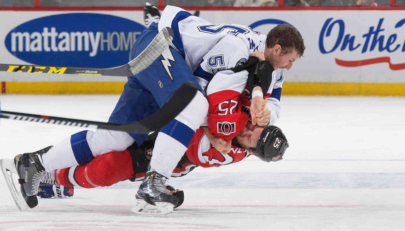 Here are some of the images that caught our eye on the sports night of Feb. 8, starting with Braydon Coburn of Tampa Bay wrestling with Chris Neil of Ottawa.