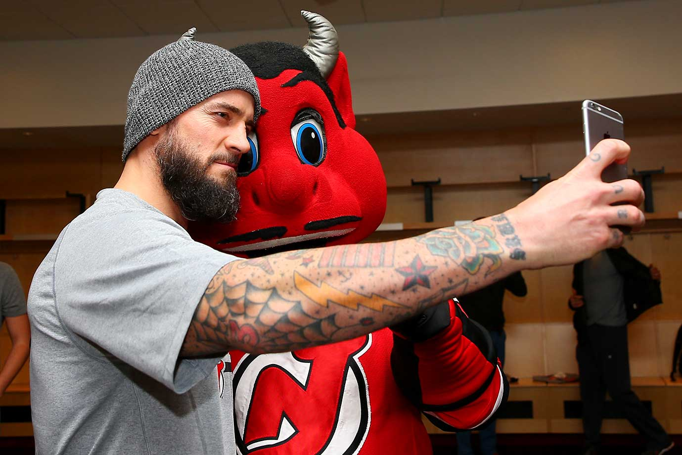 "UFC fighter Phil ""CM Punk"" Brooks takes a selfie with New Jersey Devils mascot ""NJ"" at the Amerihealth Pavilion in Newark."