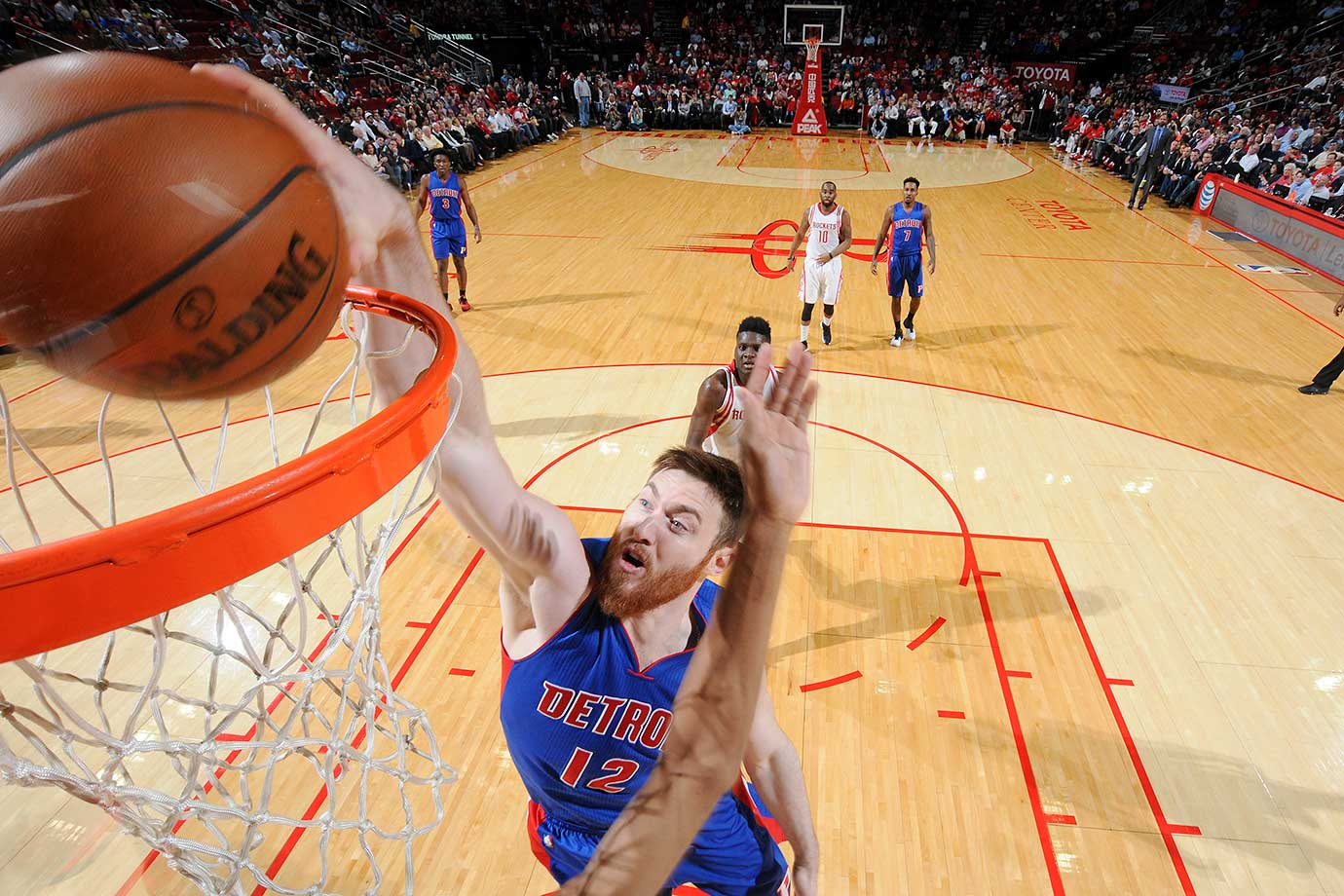 Aron Baynes of the Detroit Pistons dunks against the Houston Rockets at the Toyota Center in Houston.