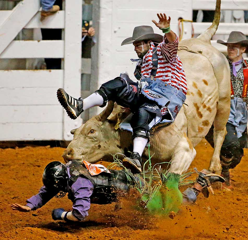 Jordan Spears managed to hang on to Haunted Mesa for 8.0 seconds, but the bull turned on him and one of the bullfighting clowns came to the rescue, but got hit by the bull as well during the second night of competition in the Bulls' Night Out at the Fort Worth Stock Show Rodeo in Fort Worth.