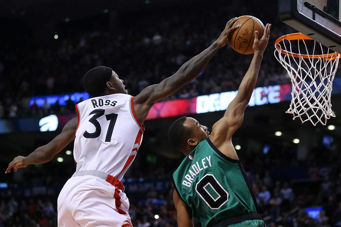 Terrence Ross blocks a Avery Bradley shot  as the Toronto Raptors beat the Boston Celtics 115-109  at the Air Canada Centre in Toronto.
