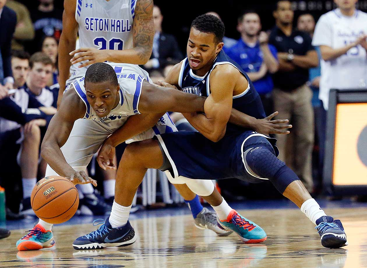 Seton Hall guard Isaiah Whitehead and Villanova guard Phil Booth compete for the ball in Newark, N.J. Villanova won 72-71.