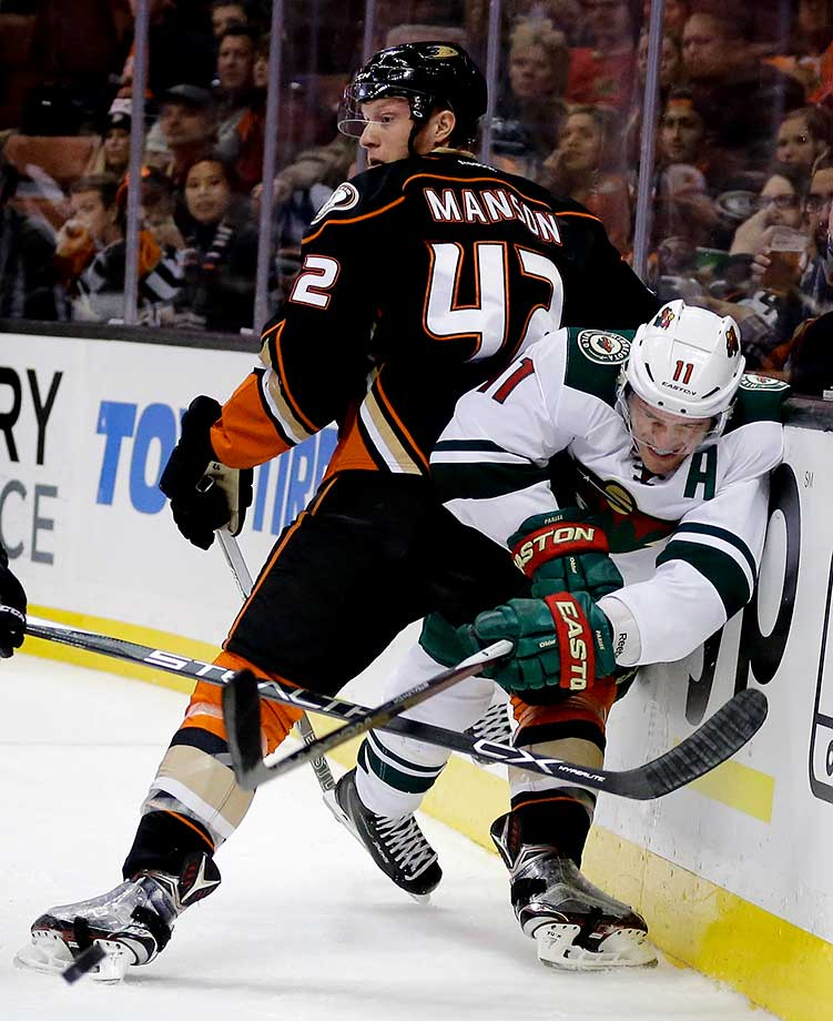 Minnesota Wild left wing Zach Parise, passes around Anaheim Ducks defenseman Josh Manson in Anaheim, Calif.