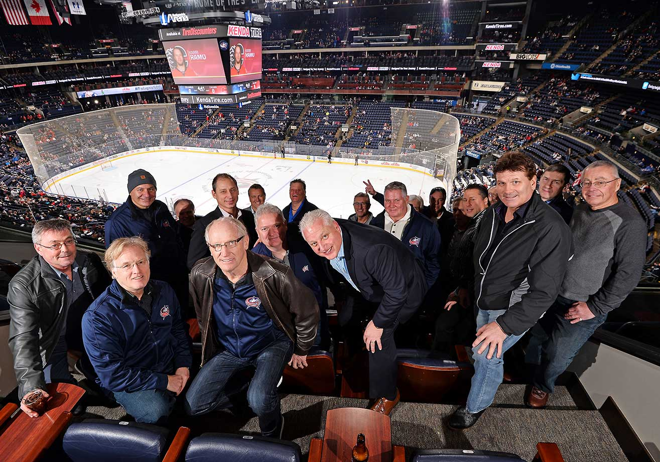 The fathers of Columbus Blue Jackets players pose for a photo prior to a game against the Calgary Flames at Nationwide Arena in Ohio.