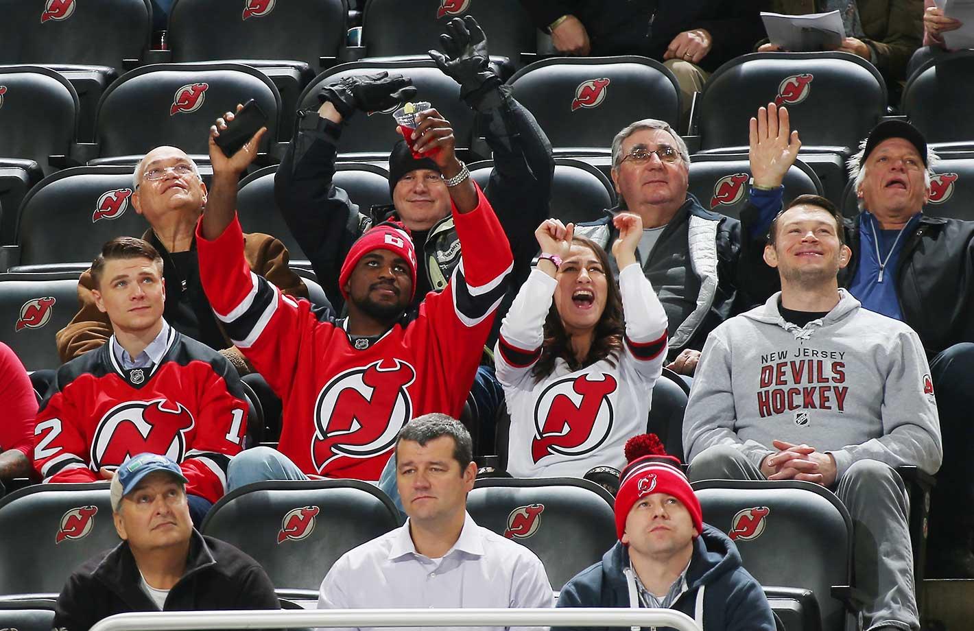 Chris Wade, Corey Anderson, Jessica Eye and Forrest Griffin of the UFC take in the game between the New Jersey Devils and the Ottawa Senators at the Prudential Center in Newark.