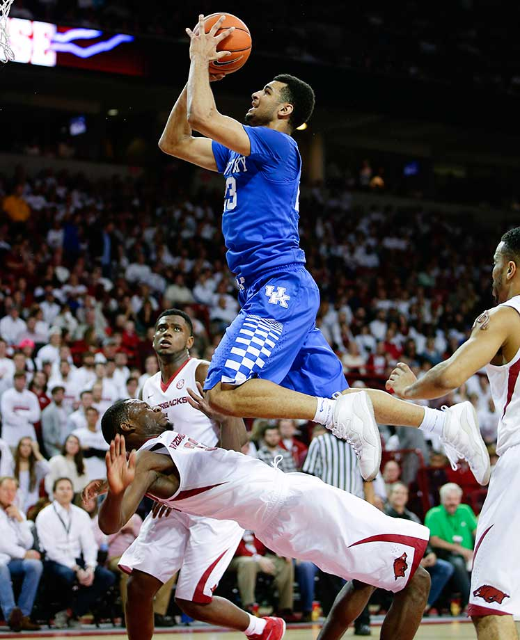 Kentucky's Jamal Murray scores and draws a foul on Arkansas' Moses Kingsleyat Bud Walton Arena in Fayetteville.