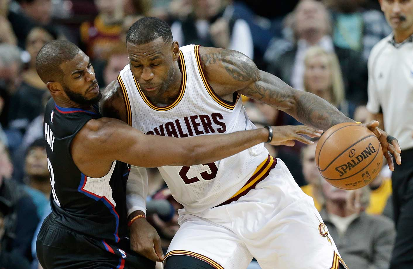 LeBron James drives past Chris Paul during a 115-102 home win.