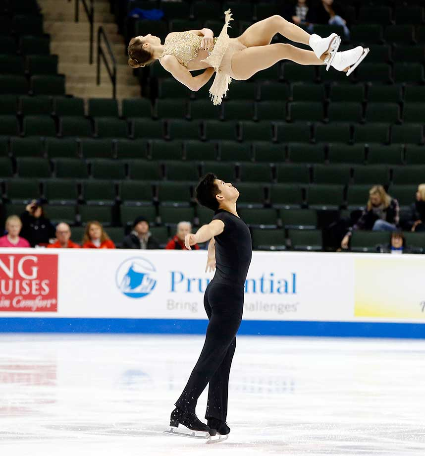 Pairs skaters Marissa Castelli and Mervyn Tran perform in the short program of the U.S. Figure Skating Championships in St. Paul, Minn.