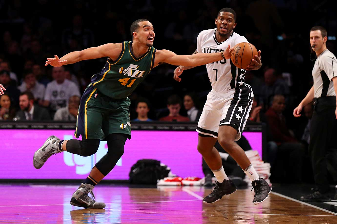 Trey Lyles of the Utah Jazz and Joe Johnson of the Brooklyn Nets pursue the loose ball at the Barclays Center in Brooklyn.