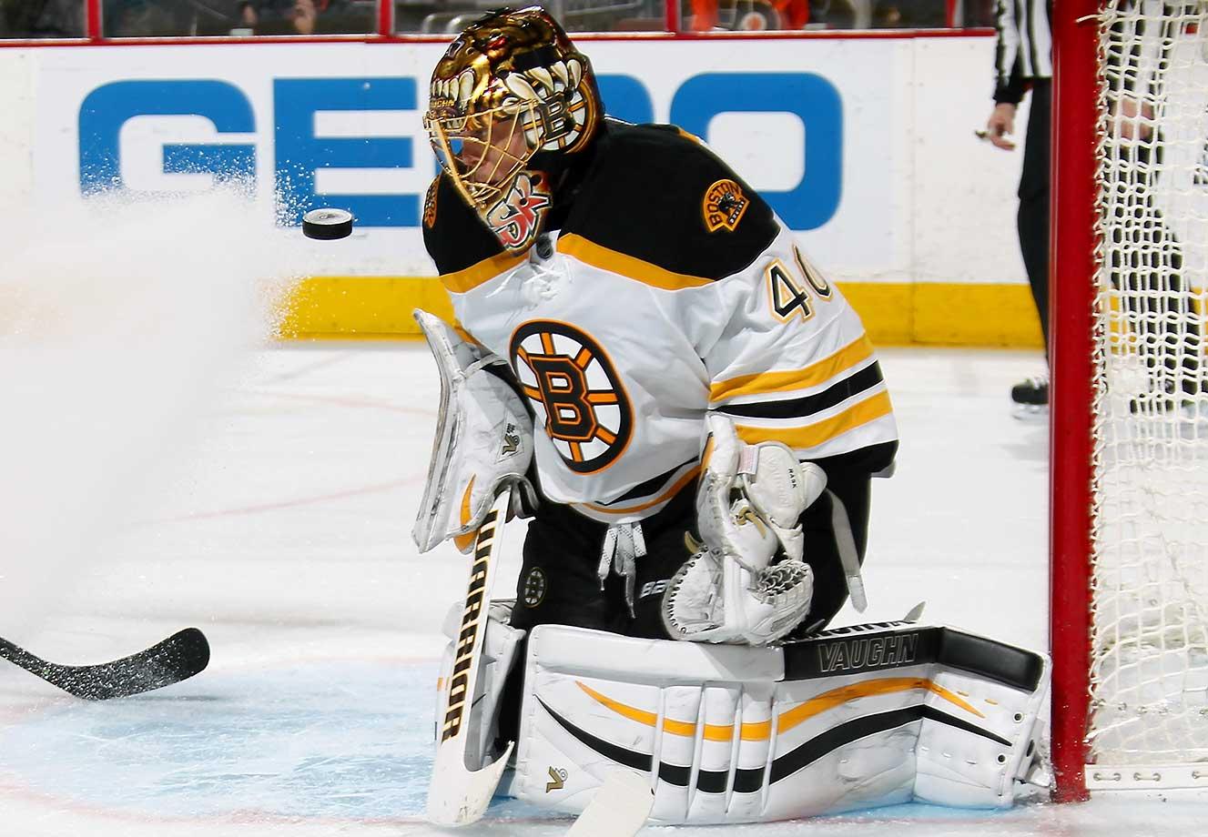 Tuukka Rask of the Boston Bruins tracks the puck as it is shot towards his mask against the Philadelphia Flyers at the Wells Fargo Center in Philadelphia.