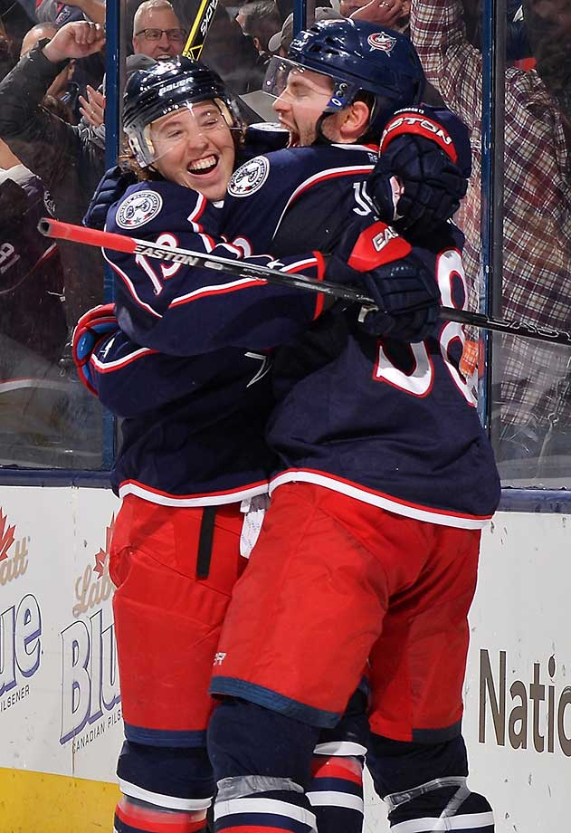 Cam Atkinson (left) of the Columbus Blue Jackets celebrates his hat trick goal with teammate Boone Jenner during the third period of a game against the Montreal Canadiens at Nationwide Arena in Ohio. Columbus defeated Montreal 5-2.