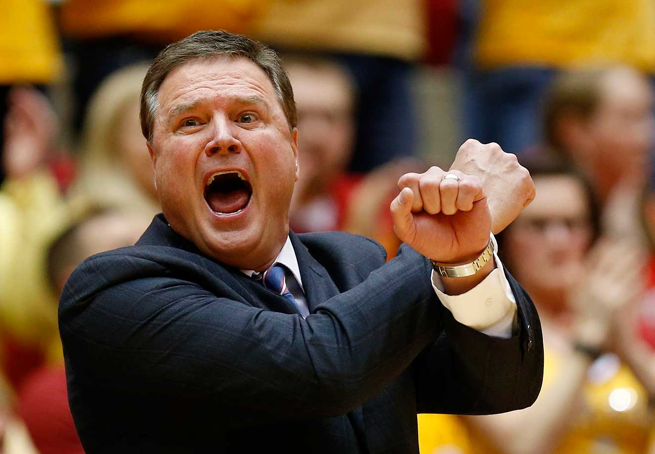 Head coach Bill Self of the Kansas Jayhawks signals a play from the bench against the Iowa State Cyclones at Hilton Coliseum in Ames, Iowa.