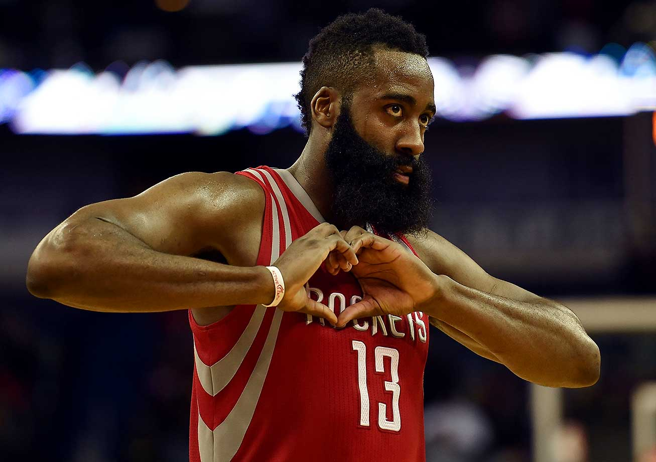 James Harden of the Houston Rockets signals to fans during a game against the New Orleans Pelicans at the Smoothie King Center in New Orleans.