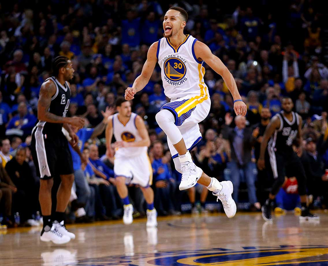 Stephen Curry reacts after he made a shot against the San Antonio Spurs at ORACLE Arena in Oakland.