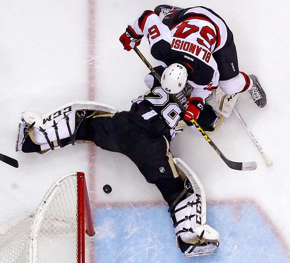 New Jersey Devils' Joseph Blandisi can't get to the puck behind Pittsburgh Penguins goalie Marc-Andre Fleury, who got the shutout in a 2-0 Penguins win.