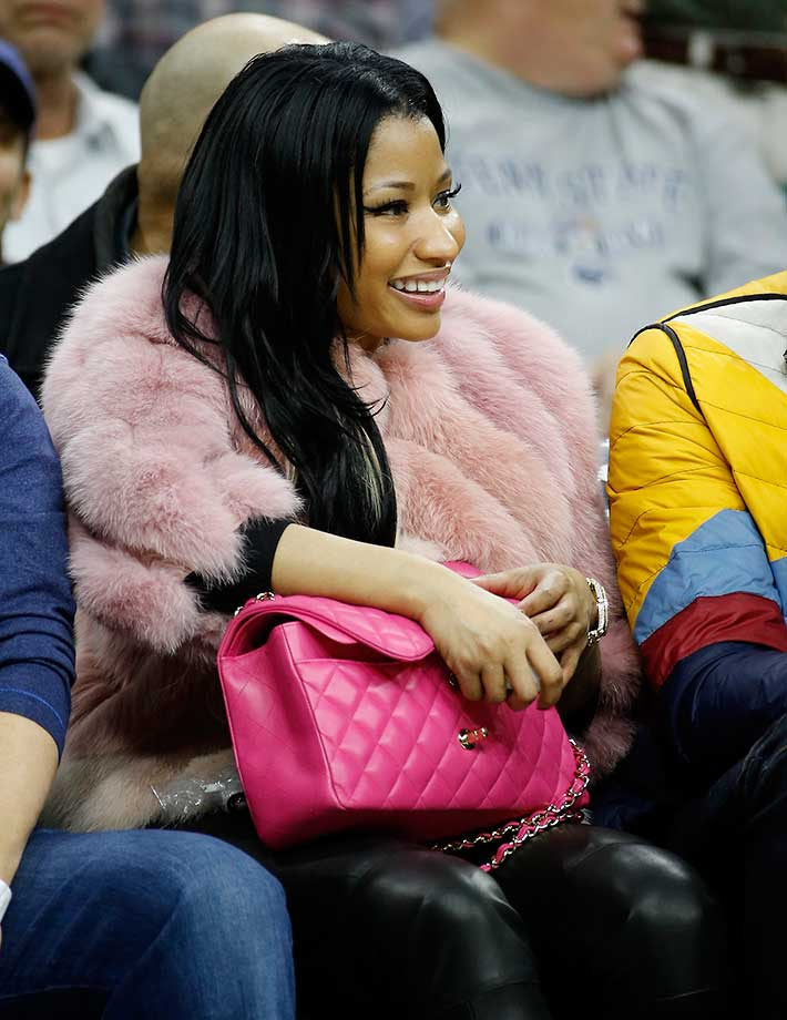 Nicki Minaj watches the Philadelphia 76ers and the Phoenix Suns in Philadelphia.
