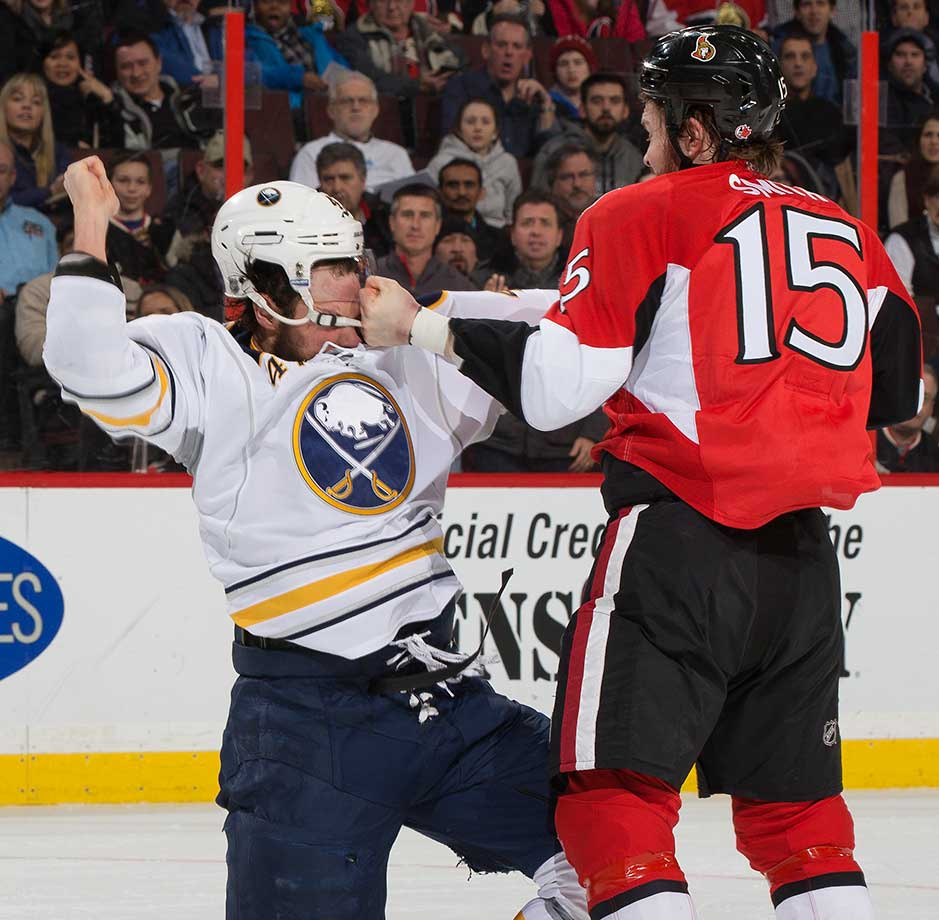 Here are some of the images that caught our eye on the sports night of Jan. 26, starting with Zach Bogosian of the Buffalo Sabres getting nailed by a punch from Zack Smith of the Ottawa Senators at Canadian Tire Centre in Ottawa.