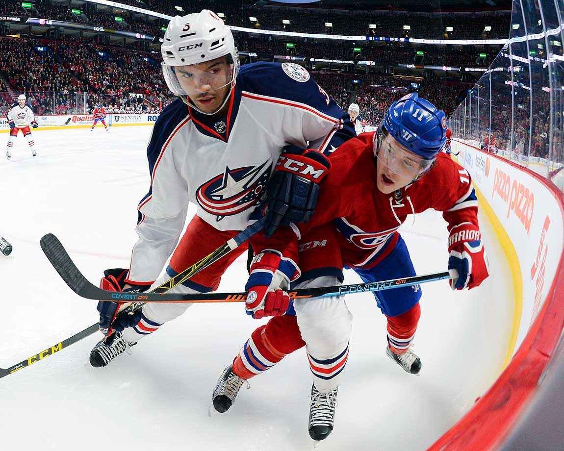 Brendan Gallagher of the Montreal Canadiens and Seth Jones of the Columbus Blue Jackets fight for the puck at the Bell Centre in Montreal.