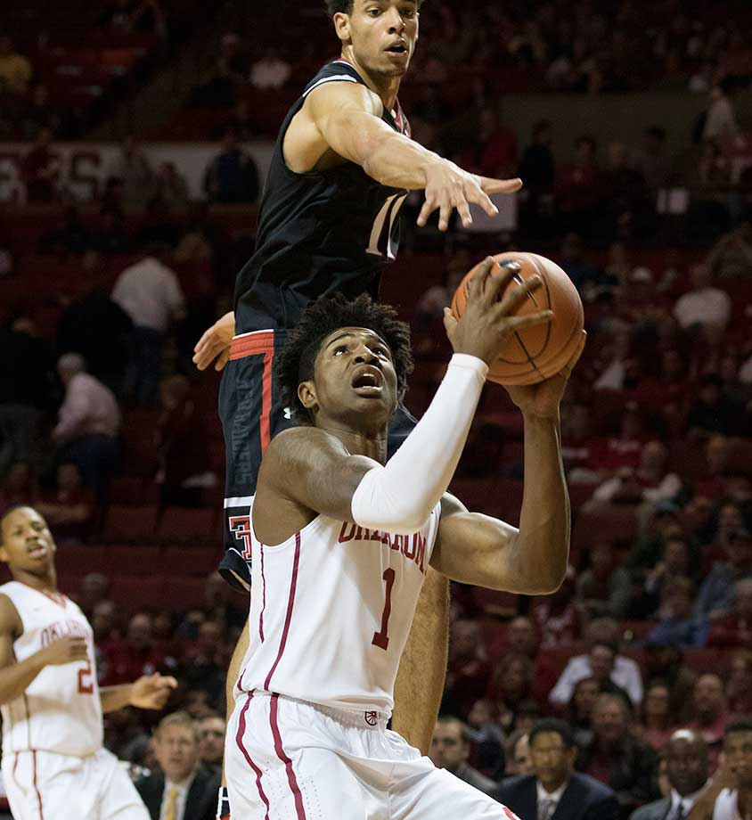Zach Smith of the Texas Tech Red Raiders goes over Rashard Odomes of Oklahoma to try to block his shot at the Lloyd Noble Center in Norman, Okla.