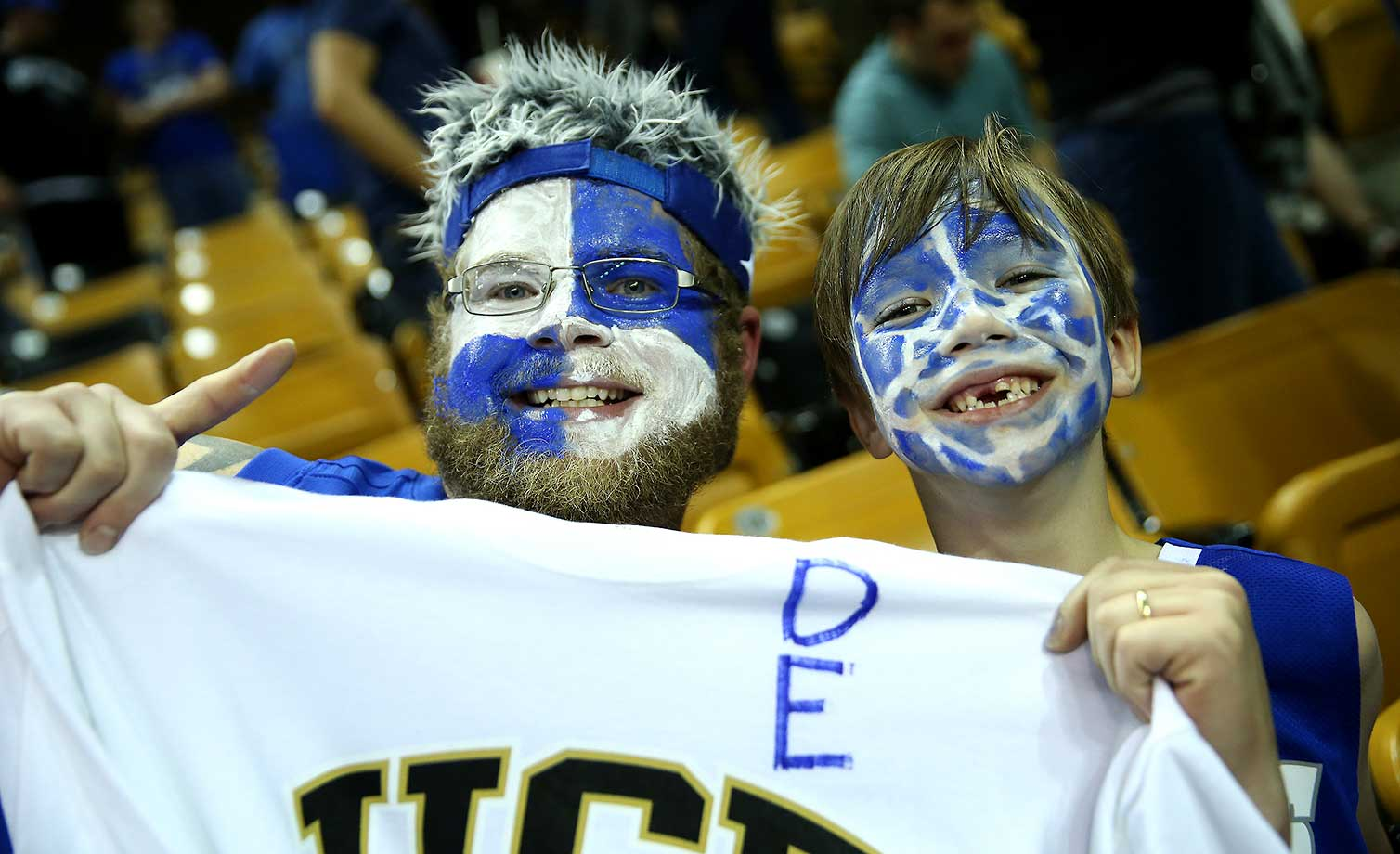 Memphis Tiger fans smile during a game between the Memphis Tigers and the UCF Knights at the CFE Arena in Orlando.